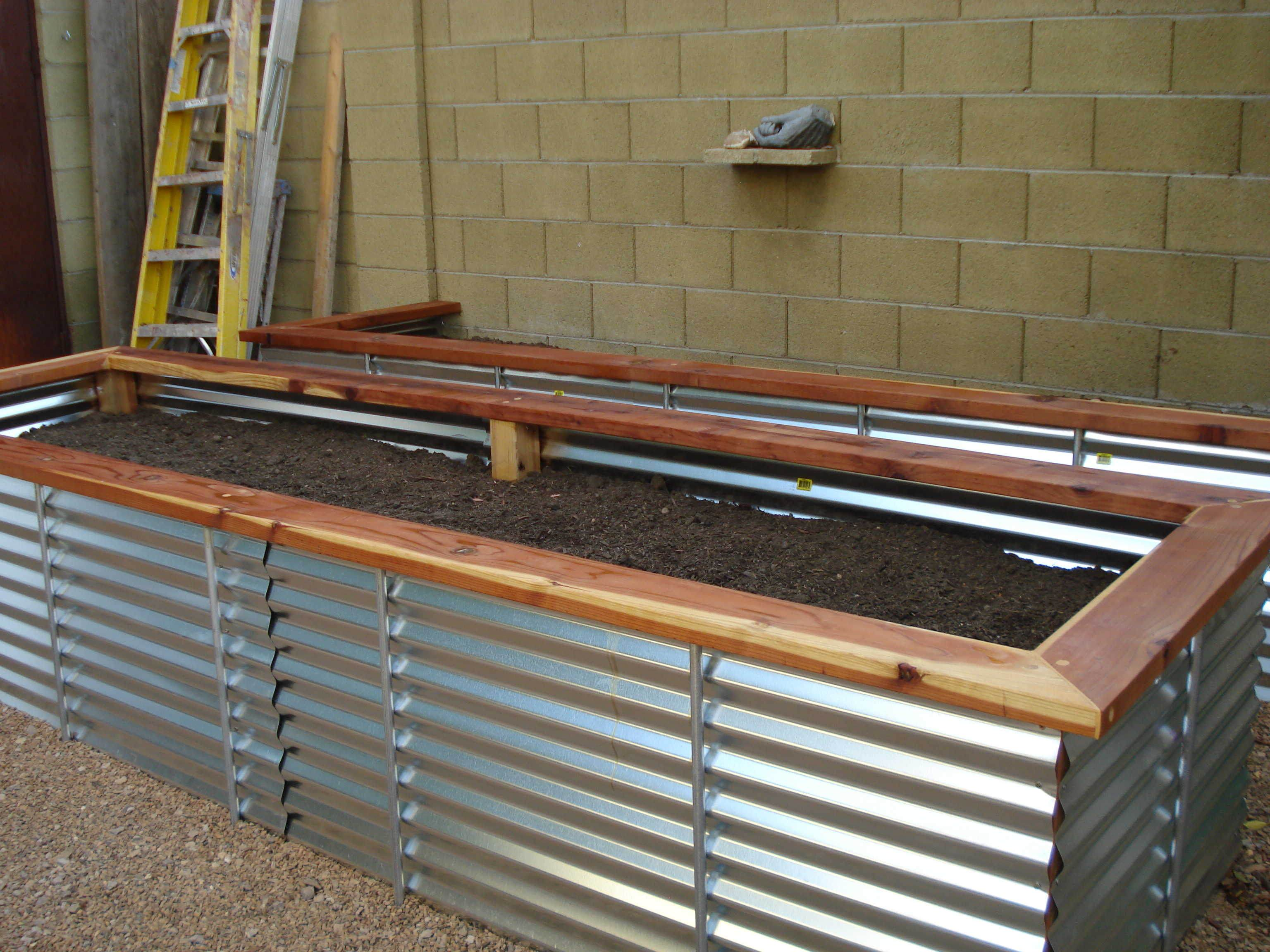 12 diy raised garden bed ideas for Corrugated metal raised garden beds