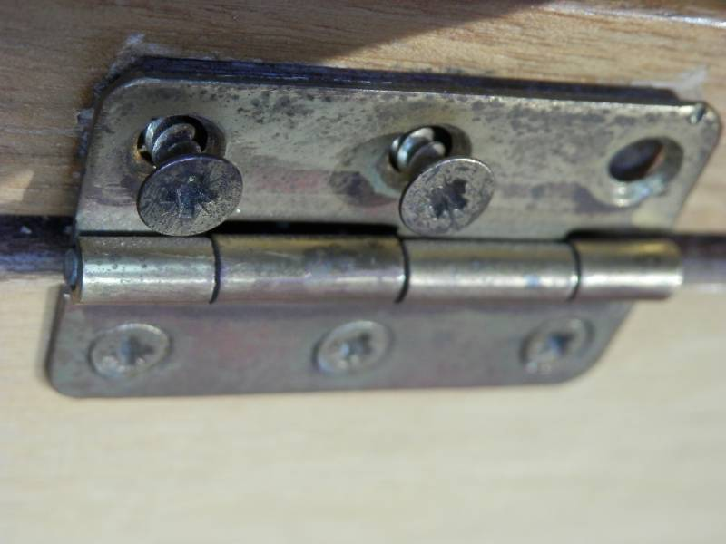 Re install The Hinges To Fix A Cabinet Door That Fell Off The Hinges
