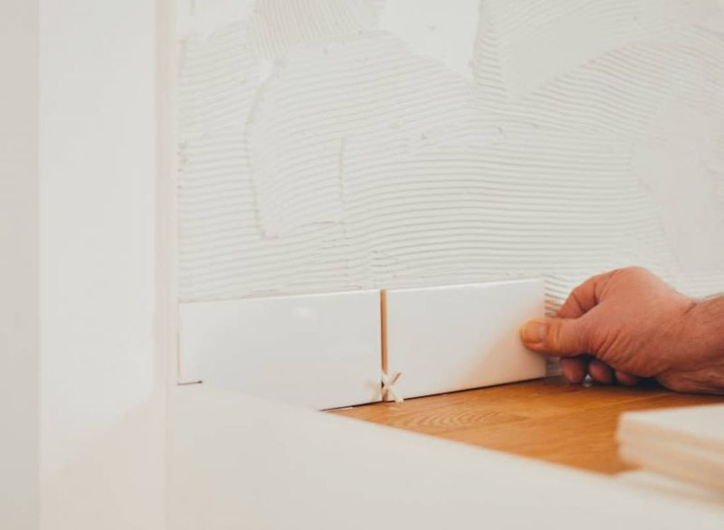 Gluing Tiles To The Wall (1)